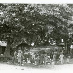 Oshu market scene under trees
