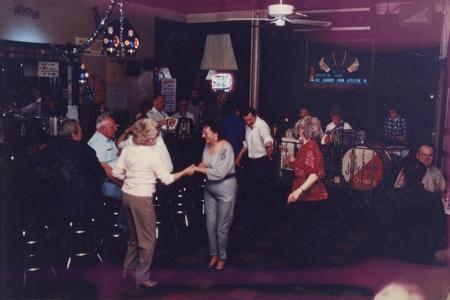 Dancers jitterbug to German-American band