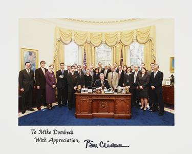 White House Oval Office photo of administrators with President Bill Clinton