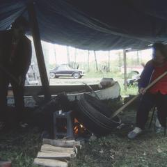 George and Mary McGeshick parch wild rice in their camp