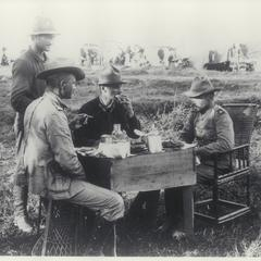 General Funston and aides take a meal in the field, early 1900s