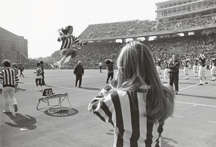 UW cheerleaders with trampoline