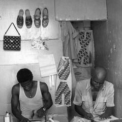 Two Shoemakers at Work
