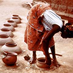 Woman Making Water Pots