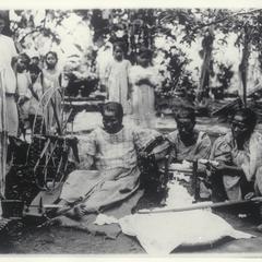 Women ginning, carding, spinning and weaving cotton, Calaca, Batangas, 1905-1915