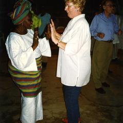 Woman teaching someone to dance