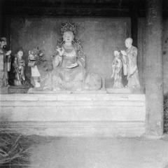 Statue of Guanyin 觀音 on chilin with entourage.