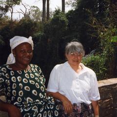 Two women on bridge in Kintampo Falls