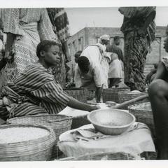 Selling maize at Oshu market