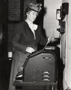 Helen C. White at mimeograph machine