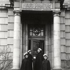 Nursing students on dormitory steps