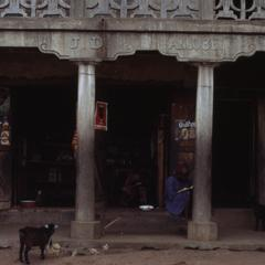 Mrs. Olyemi's shop with people and goat