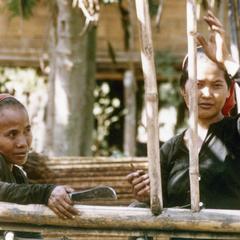 Two Khmu' women make repairs to a fence in Houa Khong Province