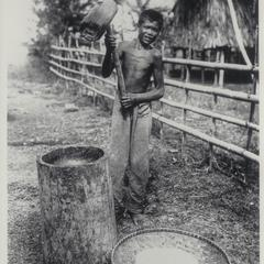 Peasant pounding rice, early 1900s