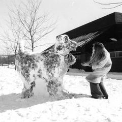 Student and snow sculpture