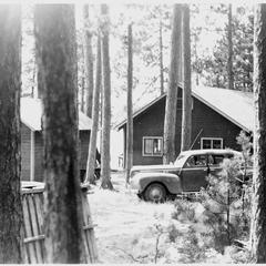 Car amongst the cabins