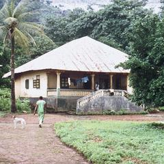Typical Concrete House with Corrugated Tin Roof (Pan Roof) at Kamabai