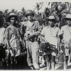 Private First Class Wolcott with Filipinos, Lingayen Gulf, 1945
