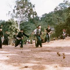 White Hmong boys playing tops in the village of Nam Phet in Houa Khong Province