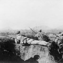 Chinese soldiers in a trench.
