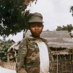 Young Lu boy soldier in the village of Ta Fa in Houa Khong Province