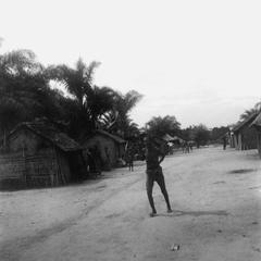 Kuba-Ngeende Woman Running through Streets in Grief