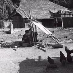 Two Yao (Iu Mien) women sewing in Houa Khong Province