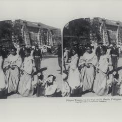 Filipino women and American soldiers by wall of Old Manila, Intramuros, ca. 1899