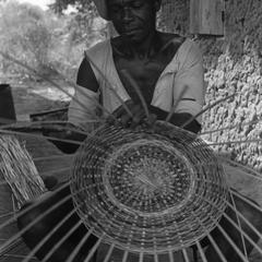 Man Weaving Basket