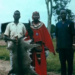 A Sub-Chief of the Basengeles Standing Beside Civet Cat Skin