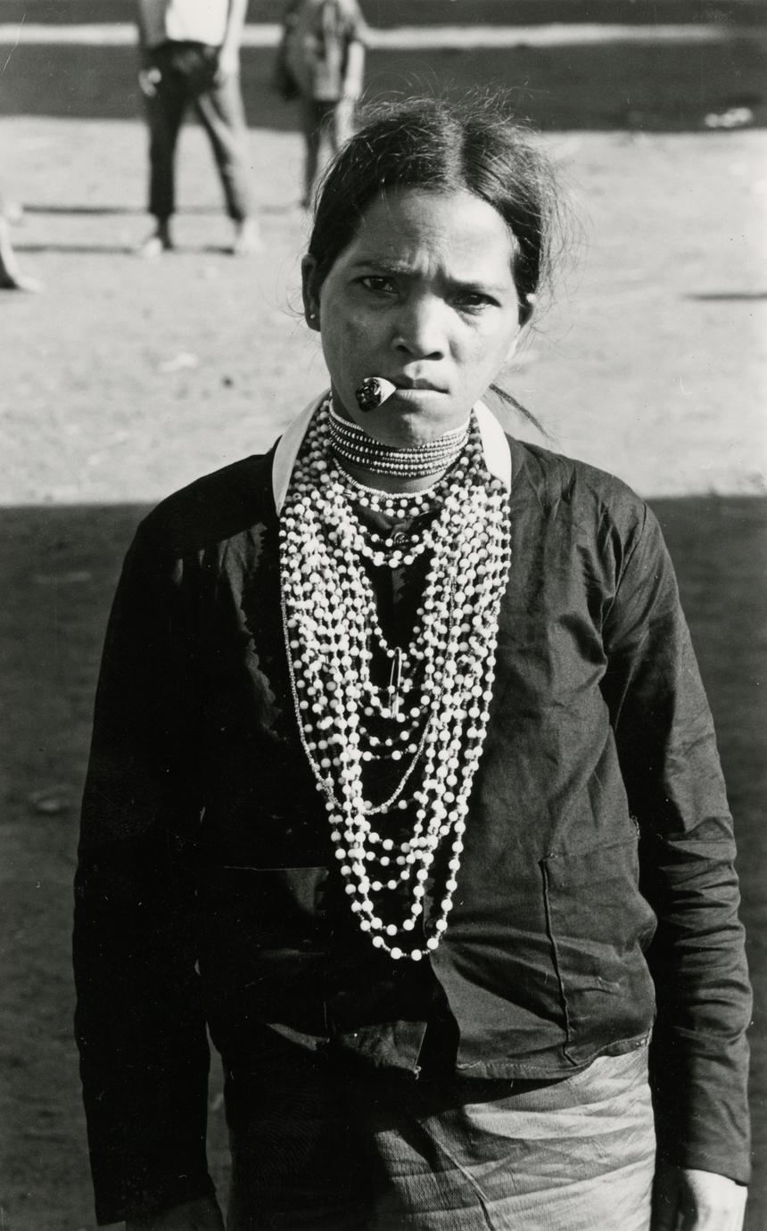A Nyaheun woman smokes a homemade cigarette in Attapu Province