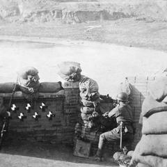 Two fully armed Japanese soldiers guarding a fortification.