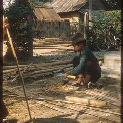 Kammu (Khmu') boy splitting bamboo for our fence