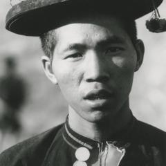 An Akha young man poses in a traditional hat in Houa Khong Province