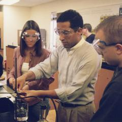 Chemistry professor Mohamed Ayoub with students in lab