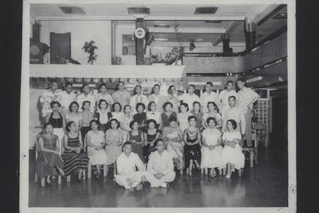 Rows of classmates of former cadets and their friends at a reunion many years after graduation