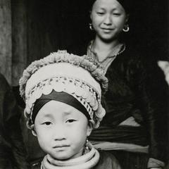 A Blue Hmong (Hmong Njua) girl stands in a village in Muang Vang Vieng in Vientiane Province