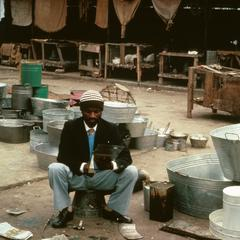 Craftsman in Market Making Utensils from Recycled Tin