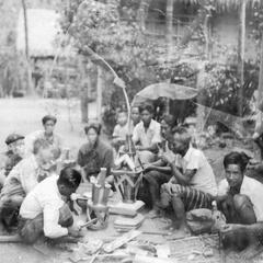 Village men making bamboo decorations for the vat