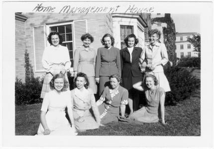 Students on the lawn of the Home Management House