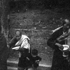 Woman providing food for monks