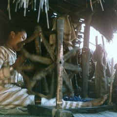 A White Lahu (Lahu Hpu) woman spins threads in the village of Chalopha in Houa Khong Province