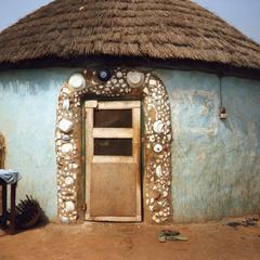 Doorway decorated with broken crockery