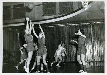 Women's Athletic Association members playing basketball