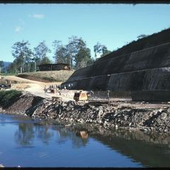 Below dam--excavating