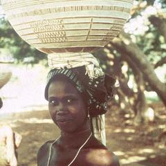 Young Woman Carrying Milk Curds and Sorghum Flour in Carved Calabashes