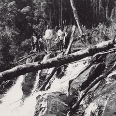 Villagers and the District Chief, Mr. Tong, inspect the pipes that carry the water to Houei Kong in Attapu Province
