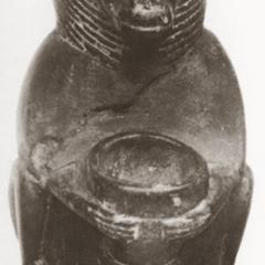 Baboon holding jar