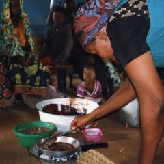 Woman Cooking shea butter