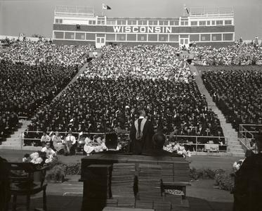 Graduates and audience at Camp Randall